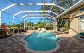 Rich brick pavers frame the pool and spa - Single Family Home for sale at 2522 Tom Morris Dr, Sarasota, FL 34240 - MLS Number is A4423908