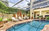 Another view of pool area - Single Family Home for sale at 121 N Casey Key Rd, Osprey, FL 34229 - MLS Number is A4425715