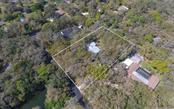 aerial picture of the house and land. - Single Family Home for sale at 2215 Shadow Wood Ln, Sarasota, FL 34240 - MLS Number is A4427846