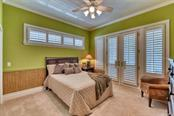 Bedroom 3, plantation shutters, access to wrap-around decking. - Single Family Home for sale at 737 Eagle Point Dr, Venice, FL 34285 - MLS Number is A4428917