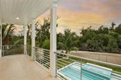 Single Family Home for sale at 6941 Longboat Dr S, Longboat Key, FL 34228 - MLS Number is A4429320