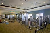 Full fitness center at The Lodge with treadmills and ellipticals as well - Single Family Home for sale at 5504 Tidewater Preserve Blvd, Bradenton, FL 34208 - MLS Number is A4429479