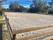 50 x 100 ft riding arena with 9 inch deep multi layered surface - Single Family Home for sale at 29215 Saddlebag Trl, Myakka City, FL 34251 - MLS Number is A4431037