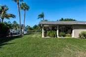 Outdoor living space overlooking the canal - Single Family Home for sale at 602 Baronet Ln, Holmes Beach, FL 34217 - MLS Number is A4447974
