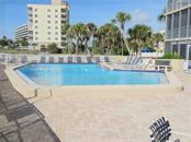 View of the pool which is at the north end of the building; your unit is at the south end of the building. - Condo for sale at 555 The Esplanade N #102, Venice, FL 34285 - MLS Number is A4450635