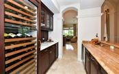 Wet bar - Single Family Home for sale at 574 N Macewen Dr, Osprey, FL 34229 - MLS Number is A4455085