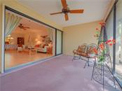 Screened Porch looking into Living Room - Villa for sale at 4335 Rum Cay Cir, Sarasota, FL 34233 - MLS Number is A4463762