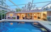 LOVELY EVENINGS ON YOUR SUNSET PATIOS - Single Family Home for sale at 3 Winslow Pl, Longboat Key, FL 34228 - MLS Number is A4464990