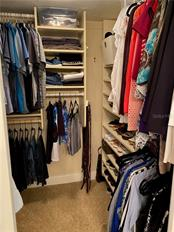 The walk in closet in the master bath has plenty of shoe storage. - Condo for sale at 5770 Midnight Pass Rd #509c, Sarasota, FL 34242 - MLS Number is A4472645