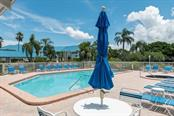 Sandpiper pool and spa. - Condo for sale at 977 Sandpiper Cir #977, Bradenton, FL 34209 - MLS Number is A4474554