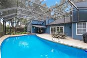 Single Family Home for sale at 5412 Beneva Woods Cir, Sarasota, FL 34233 - MLS Number is A4479206