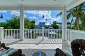 Second floor patio. - Single Family Home for sale at 718 Key Royale Dr, Holmes Beach, FL 34217 - MLS Number is A4480381