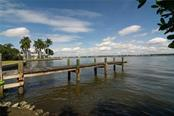 Dock and intercoastal views to the North. - Single Family Home for sale at Address Withheld, Sarasota, FL 34242 - MLS Number is A4483403