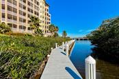 Dock on Phillippi Creek - Condo for sale at 5591 Cannes Cir #506, Sarasota, FL 34231 - MLS Number is A4484243