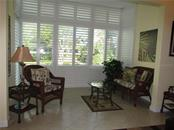 ENCLOSED LANAI WITH PLANTATION SHUTTERS VIEW OF THE LAGOON - Condo for sale at 1087 W Peppertree Dr #221d, Sarasota, FL 34242 - MLS Number is A4493593