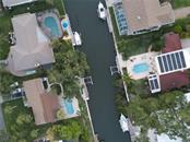 Aerial view of 1633 Ridgewood Lane residence and boat on the canal -- the lower left. - Single Family Home for sale at 1633 Ridgewood Ln, Sarasota, FL 34231 - MLS Number is A4496839