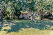 Set back from the road for privacy. - Single Family Home for sale at 7811 27th Ave W, Bradenton, FL 34209 - MLS Number is A4499385