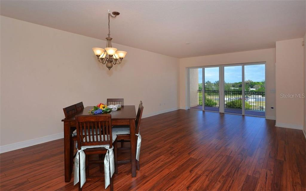 Dining Room/Great Room - Condo for sale at 167 Tampa Ave E #513, Venice, FL 34285 - MLS Number is N5911190