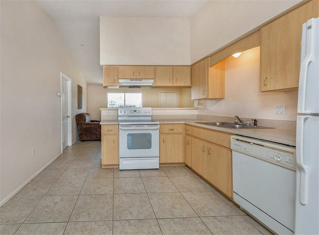 Kitchen - Single Family Home for sale at 10308 Grail Ave, Englewood, FL 34224 - MLS Number is N5911429