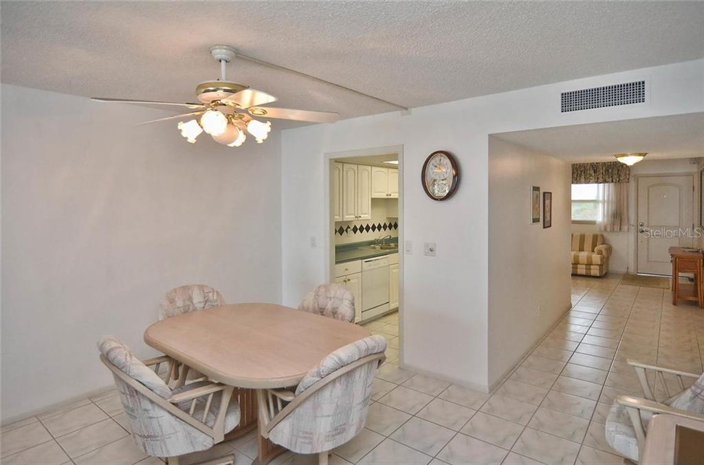 Dining room to kitchen and den - Condo for sale at 255 The Esplanade N #805, Venice, FL 34285 - MLS Number is N5912261