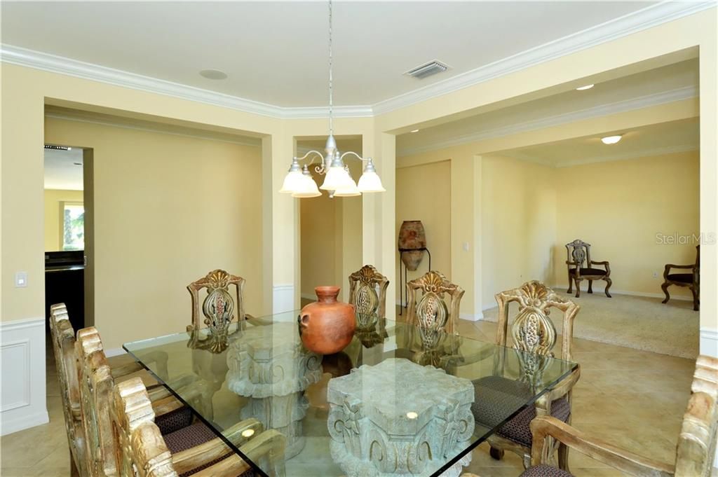 Dining room to den - Single Family Home for sale at 19168 Jalisca St, Venice, FL 34293 - MLS Number is N5912651