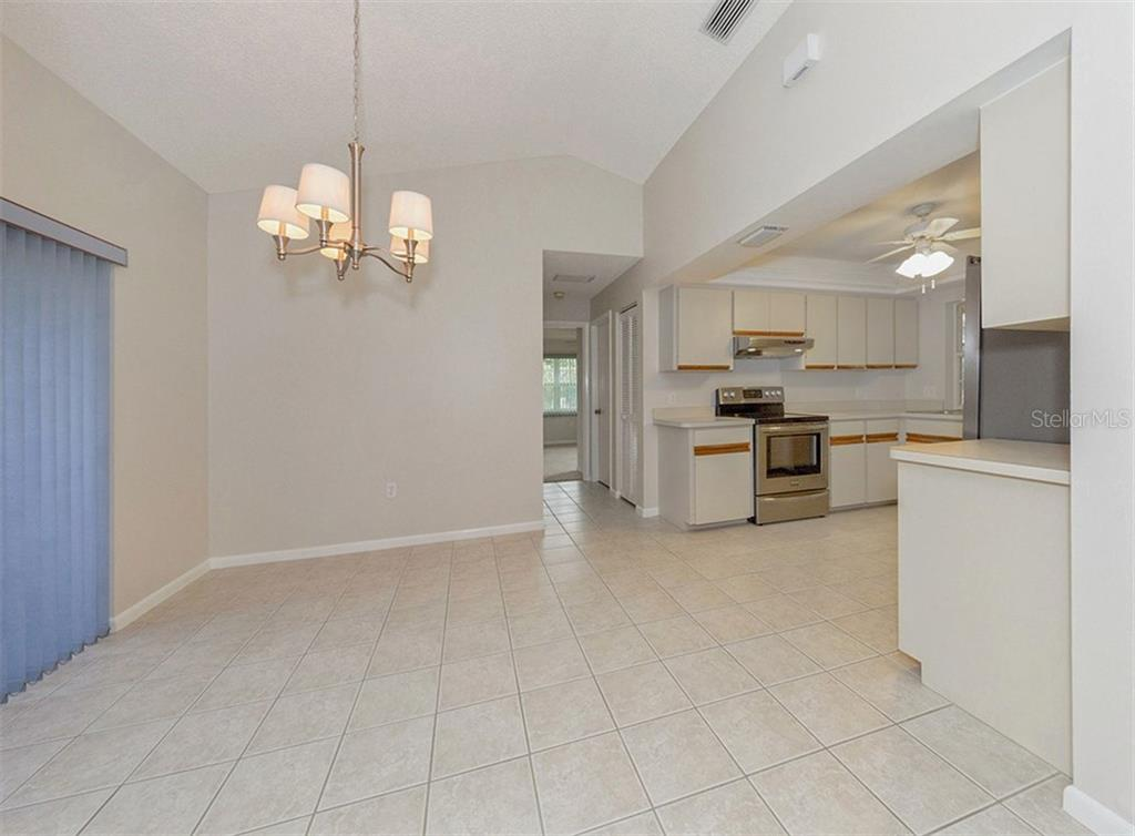 Dinette - Single Family Home for sale at 3160 Willow Springs Cir, Venice, FL 34293 - MLS Number is N5912811