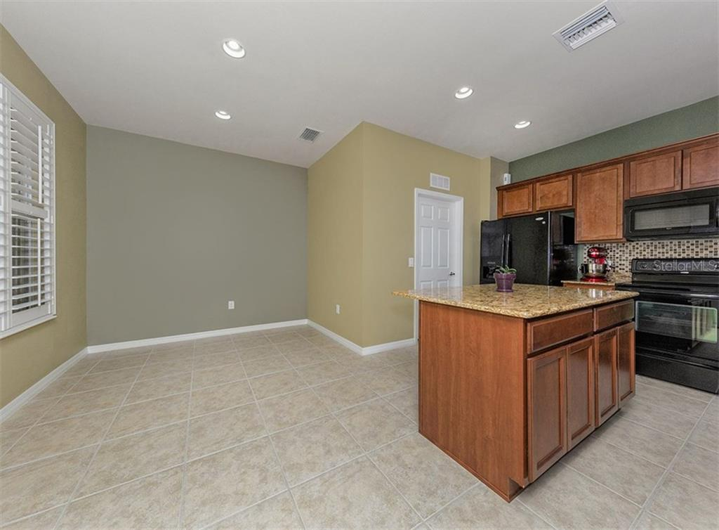 Eat-in kitchen - Single Family Home for sale at 19131 Kirella St, Venice, FL 34293 - MLS Number is N5913074