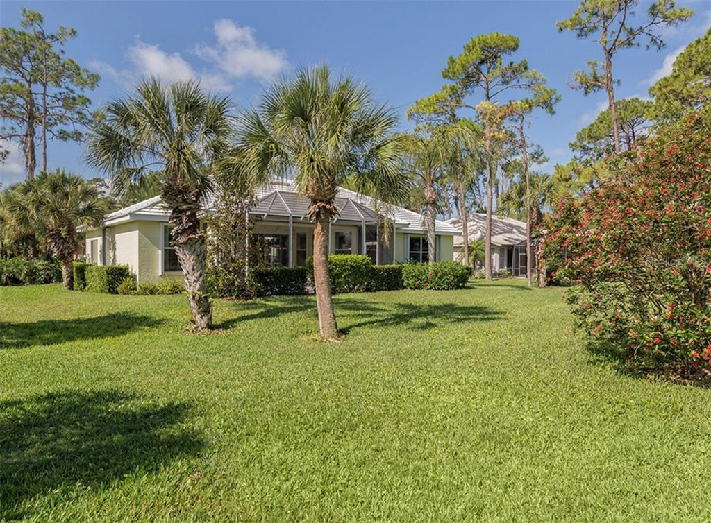 Aerial of rear exterior - Single Family Home for sale at 2122 Timucua Trl, Nokomis, FL 34275 - MLS Number is N5913111