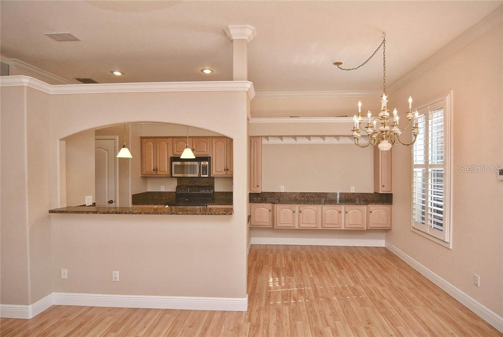 Kitchen, dining room - Condo for sale at 501 Barcelona Ave #c, Venice, FL 34285 - MLS Number is N5913183