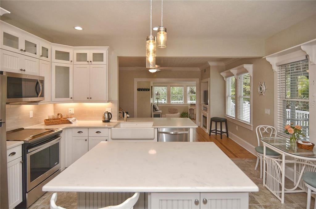 Kitchen to living room - Single Family Home for sale at 732 Eagle Point Dr, Venice, FL 34285 - MLS Number is N5913211