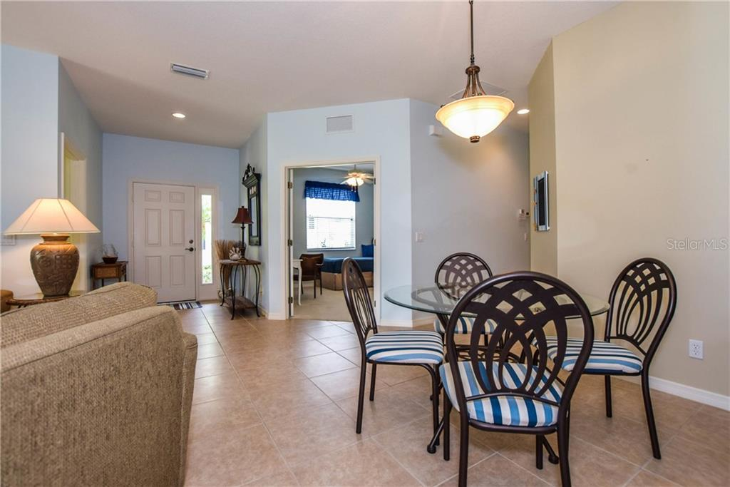 Dining Room From Front Entrance - Villa for sale at 1641 Monarch Dr #1641, Venice, FL 34293 - MLS Number is N5913259