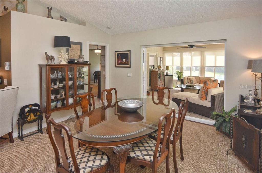 Dining room to Florida room - Single Family Home for sale at 1812 Ashley Dr, Venice, FL 34292 - MLS Number is N5914047