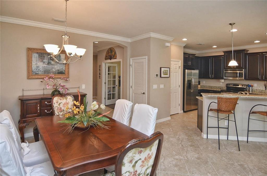 Dining room, foyer, kitchen - Single Family Home for sale at 9124 Coachman Dr, Venice, FL 34293 - MLS Number is N5914408