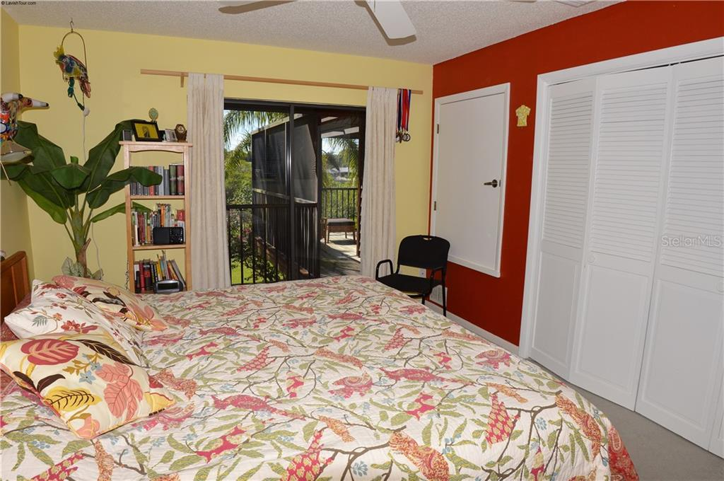Bedroom to lanai - Single Family Home for sale at 1649 Manor Rd, Englewood, FL 34223 - MLS Number is N5914466