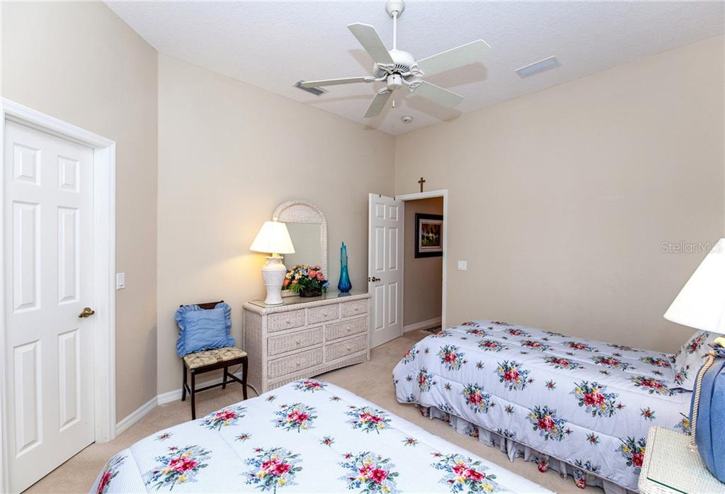 Guest Room with Large Walk-in Closet to Left - Single Family Home for sale at 366 Turtleback Xing, Venice, FL 34292 - MLS Number is N5914504