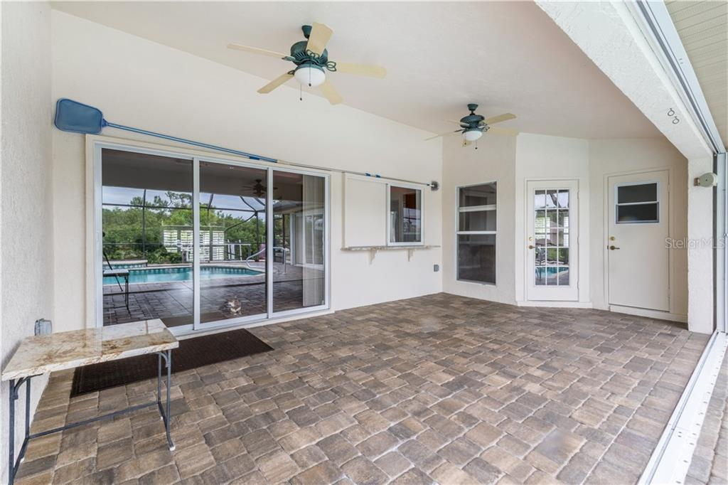 Covered Lanai area great for entertaining. - Single Family Home for sale at 5149 Latham Ter, Port Charlotte, FL 33981 - MLS Number is N5914515