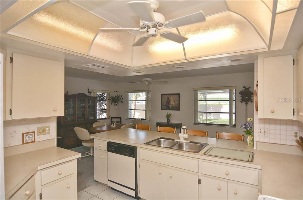 Kitchen to dining room - Single Family Home for sale at 1410 Strada D Argento, Venice, FL 34292 - MLS Number is N5914540