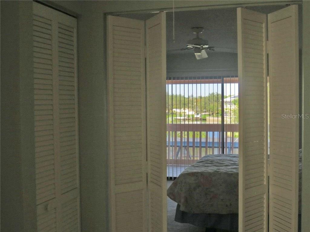 View from master bedroom to balcony - Villa for sale at 132 Inlets Blvd #132, Nokomis, FL 34275 - MLS Number is N5914693