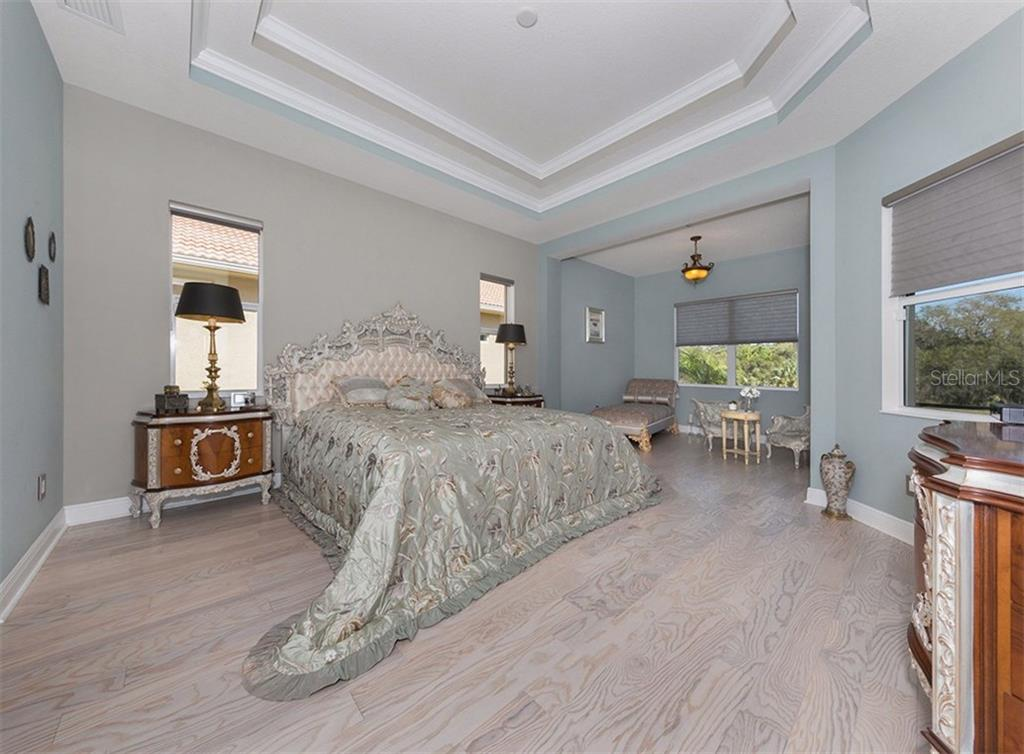 Master bedroom - Single Family Home for sale at 221 Portofino Dr, North Venice, FL 34275 - MLS Number is N5914925