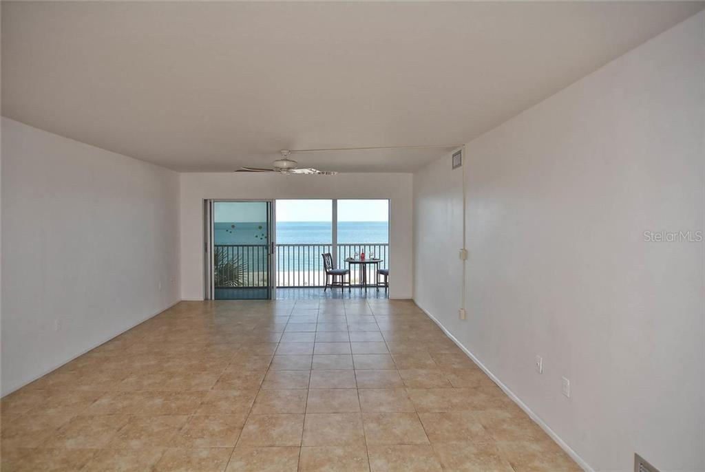 Living room with sliders to lanai with view of the Gulf - Condo for sale at 333 The Esplanade N #402, Venice, FL 34285 - MLS Number is N5914981
