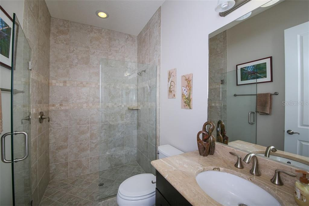 Bedroom 2 shares the pool bath and has a walk-in closet. - Single Family Home for sale at 190 Portofino Dr, North Venice, FL 34275 - MLS Number is N5915077