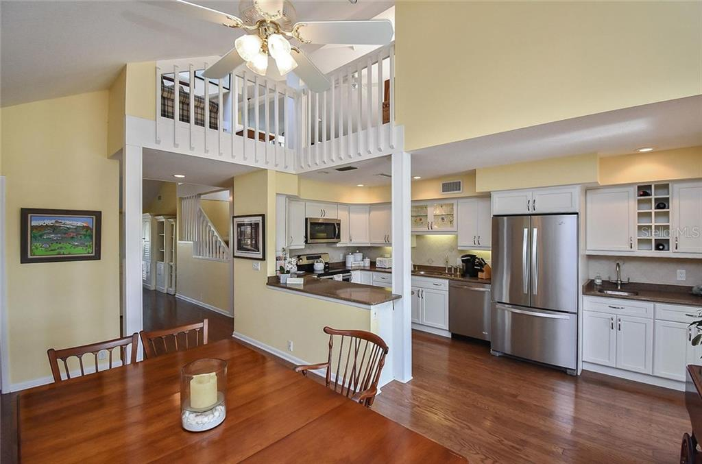 Dining room, kitchen - Single Family Home for sale at 910 Casey Cove Dr, Nokomis, FL 34275 - MLS Number is N5915385