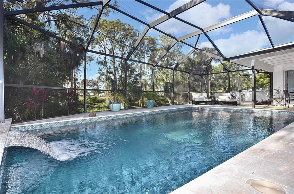 Waterfall overlooking private yard. - Single Family Home for sale at 405 Sunset Dr, Venice, FL 34285 - MLS Number is N5917234