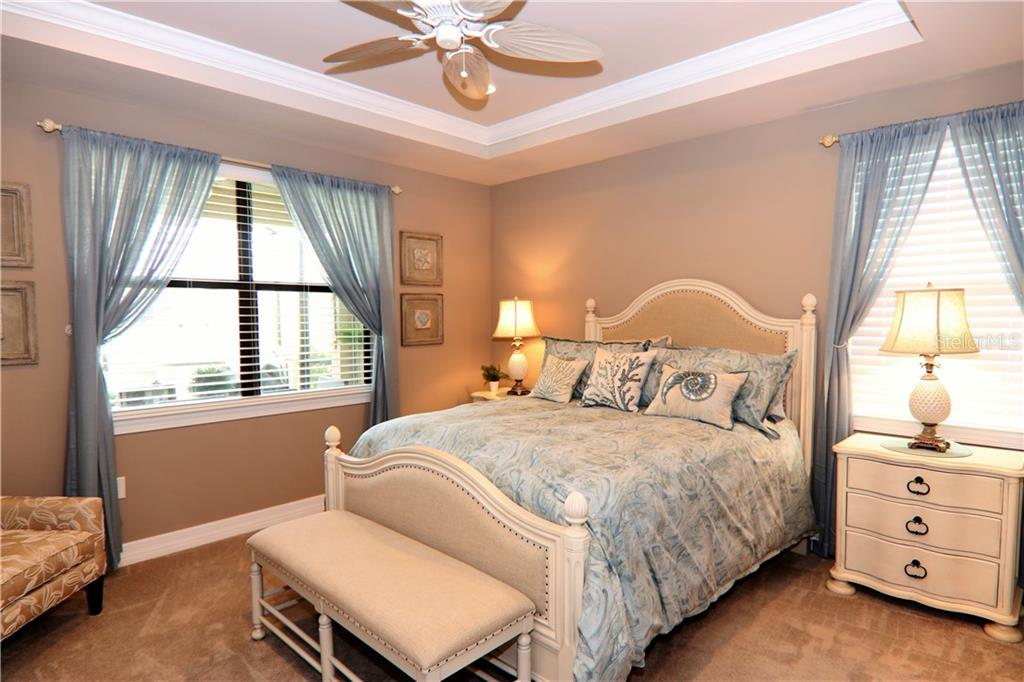 Master bedroom with tray ceilings - Single Family Home for sale at 13880 Lido St, Venice, FL 34293 - MLS Number is N5917319