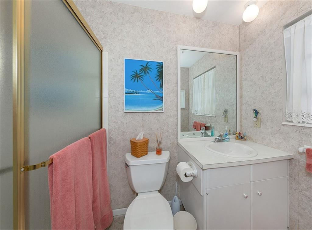 En-suite bath with easily accessible walk in shower. - Condo for sale at 100 The Esplanade N #4, Venice, FL 34285 - MLS Number is N6100334