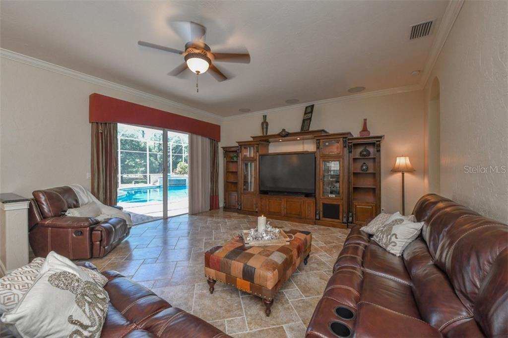 Family room - Single Family Home for sale at 5515 Reisterstown Rd, North Port, FL 34291 - MLS Number is N6100346