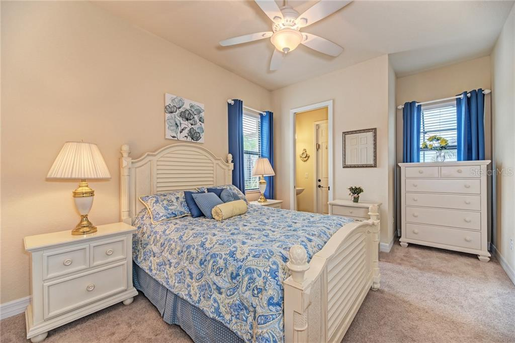 Guest bedroom with 1/2 bath that doubles as pool bath. - Single Family Home for sale at 20145 Cristoforo Pl, Venice, FL 34293 - MLS Number is N6100537