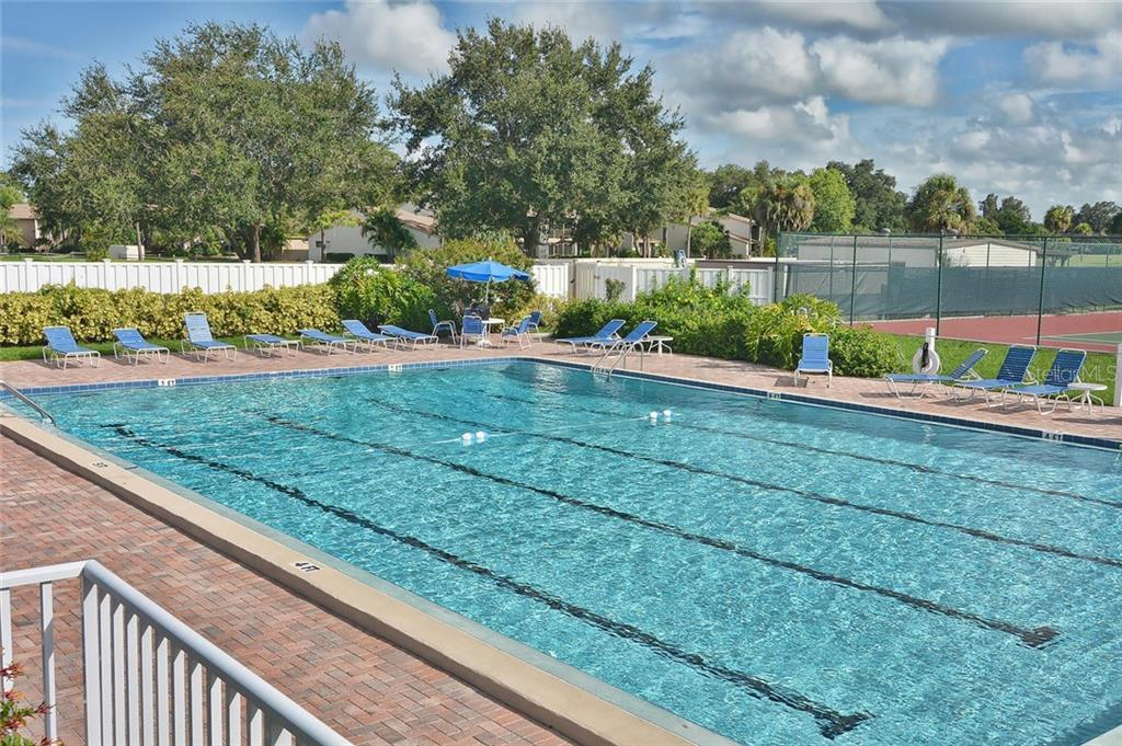 Community pool - Condo for sale at 654 Bird Bay Dr E #201, Venice, FL 34285 - MLS Number is N6101101