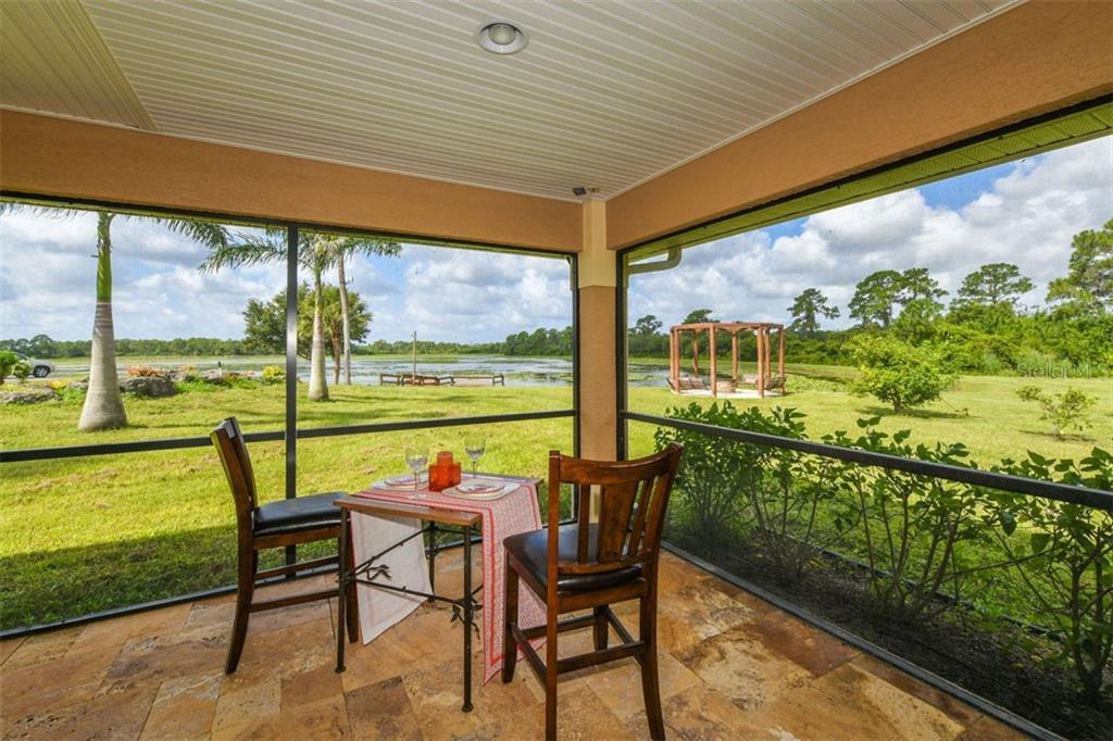 Guest house lanai with view of lake - Single Family Home for sale at 9150 Deer Ct, Venice, FL 34293 - MLS Number is N6101408