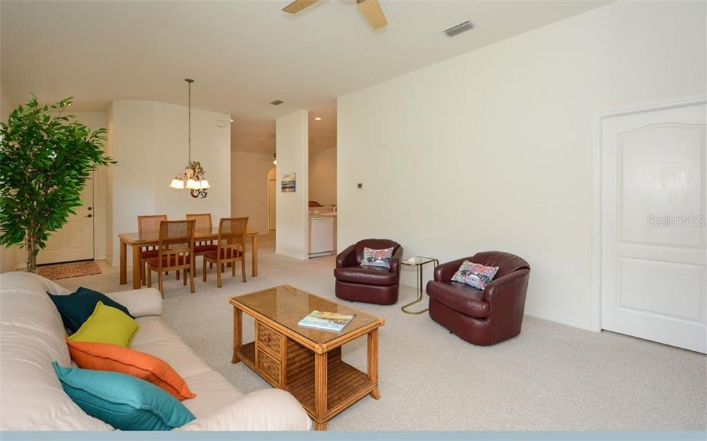 Great room to dining area and kitchen - Villa for sale at 313 Auburn Woods Cir, Venice, FL 34292 - MLS Number is N6101432